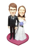 Arm In Arm Bride And Groom bobblehead Doll