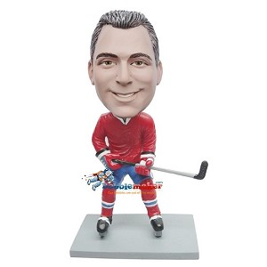 Hockey Playing Man With Stick bobblehead Doll