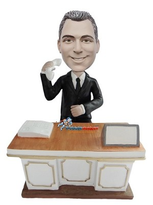 Businessman Answering Phone At Desk bobblehead Doll