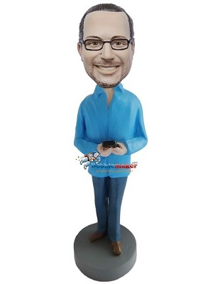 Man Holding Phone bobblehead Doll