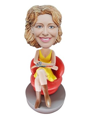 Yellow Dress Seated Businesswoman bobblehead Doll
