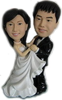 Bride And Groom Share A Dance bobblehead Doll