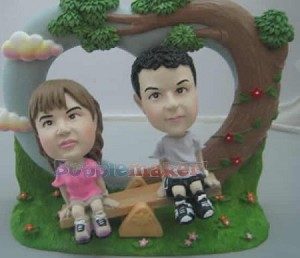 See Saw Couple bobblehead Doll