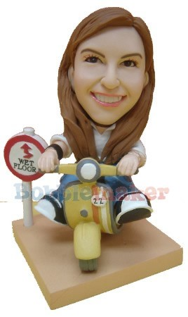 Scooter Riding Female bobblehead Doll