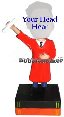 Graduate Holds Up Degree bobblehead Doll