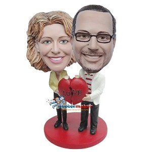Couple Holding Two Halves Of Heart bobblehead Doll
