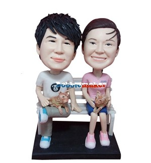 Couple With Puppies On Bench bobblehead Doll